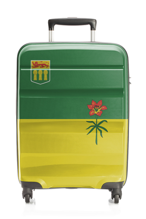 Suitcase painted into Canadian territory or province flag series - Saskatchewan