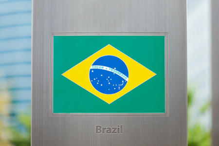 domestic policy: National flags on pole series - Brazil Stock Photo