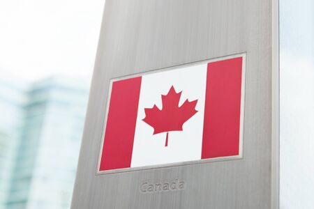 domestic policy: Series of national flags on pole - Canada Stock Photo