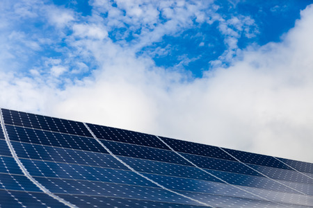 modules: Photovoltaic modules of solar panels with sky on background Stock Photo