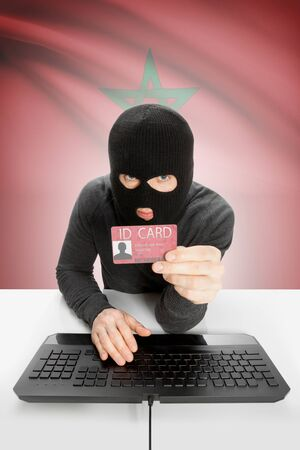 identity card: Hacker with ID card in hand and flag on background - Morocco