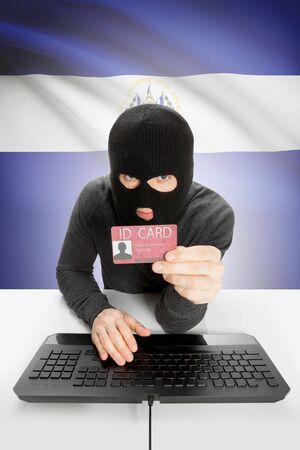 el salvadoran: Hacker with ID card in hand and flag on background - El Salvador