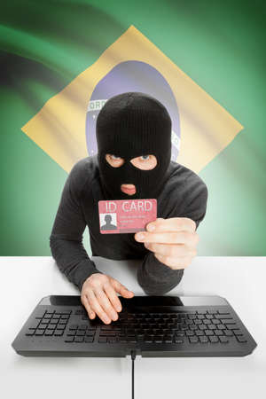 law of brazil: Hacker with ID card in hand and flag on background - Brazil