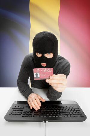 chadian: Hacker with ID card in hand and flag on background - Chad