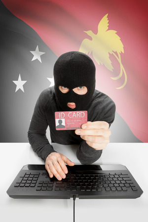 Nuova Guinea: Hacker with ID card in hand and flag on background - Papua New Guinea