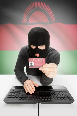 malawian flag: Hacker with ID card in hand and flag on background - Malawi Stock Photo