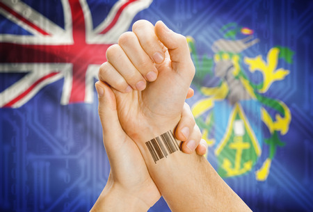 pitcairn: Barcode ID number on wrist of a human and national flag on background - Pitcairn Islands Stock Photo