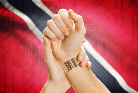 national flag trinidad and tobago: Barcode ID number on wrist of a human and national flag on background - Trinidad and Tobago