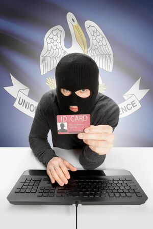 louisiana flag: Hacker with ID card in hand and USA states flag on background - Louisiana
