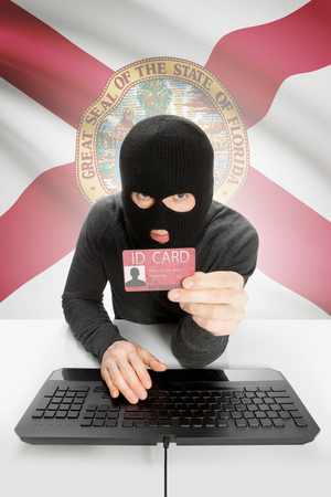 floridian: Hacker with ID card in hand and USA states flag on background - Florida