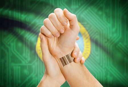 breaking the code: Barcode ID number tatoo on wrist and USA statesl flag on background - Washington