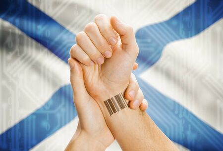 breaking the code: Barcode ID number tatoo on wrist and Canadian province flag on background - Nova Scotia