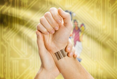 breaking the code: Barcode ID number tatoo on wrist and USA statesl flag on background - New Jersey Stock Photo