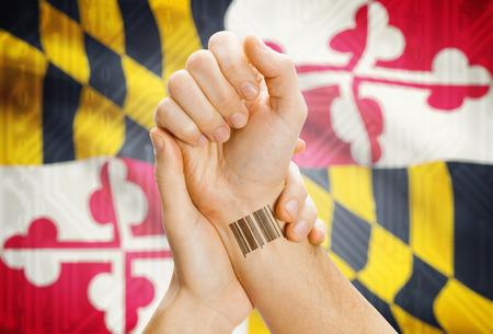 tatoo: Barcode ID number tatoo on wrist and USA statesl flag on background - Maryland