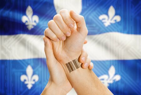 tatoo: Barcode ID number tatoo on wrist and Canadian province flag on background - Quebec
