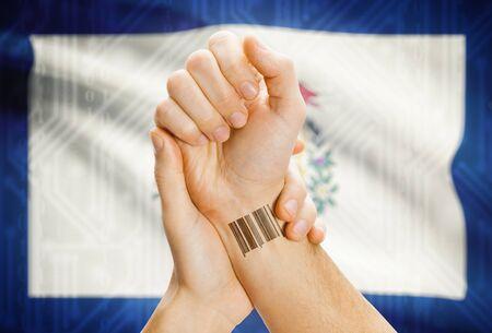 tatoo: Barcode ID number tatoo on wrist and USA statesl flag on background - West Virginia