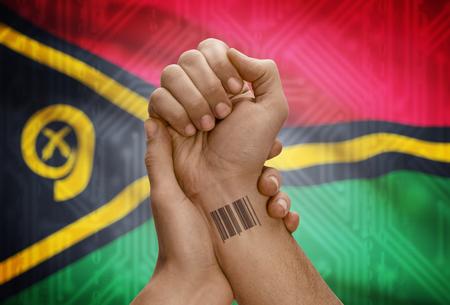 dark skinned: Barcode ID number tattoo on wrist of dark skinned person and national flag on background - Vanuatu