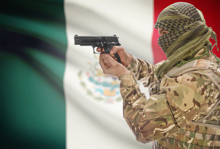 extremist: Male in muslim keffiyeh with gun in hand and national flag on background series - Mexico