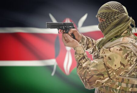 extremist: Male in muslim keffiyeh with gun in hand and national flag on background series - Kenya