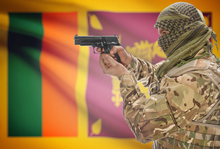 sri lankan flag: Male in muslim keffiyeh with gun in hand and national flag on background series - Sri Lanka