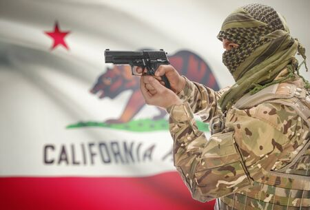 gun shot: Male in muslim keffiyeh with gun in hand and flag on background series - California