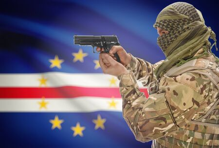 extremist: Male in muslim keffiyeh with gun in hand and national flag on background series - Cape Verde Stock Photo