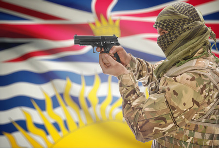 extremist: Male in muslim keffiyeh with gun in hand and Canadian province flag on background series - British Columbia