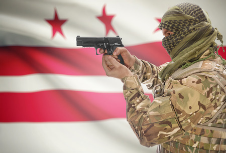 district columbia: Male in muslim keffiyeh with gun in hand and flag on background series - District of Columbia