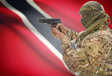 national flag trinidad and tobago: Male in muslim keffiyeh with gun in hand and national flag on background series - Trinidad and Tobago