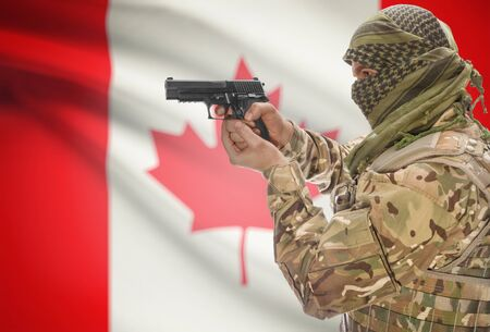 extremist: Male in muslim keffiyeh with gun in hand and national flag on background series - Canada