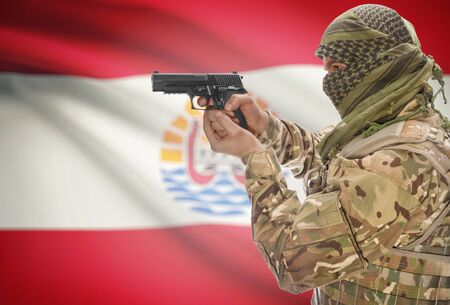 extremist: Male in muslim keffiyeh with gun in hand and national flag on background series - French Polynesia