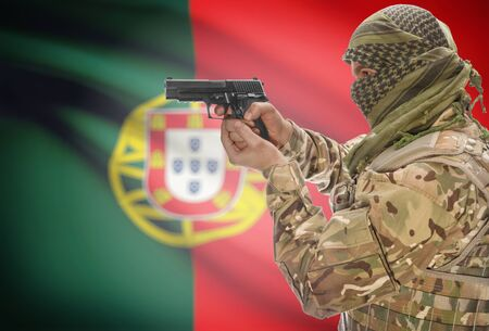 extremist: Male in muslim keffiyeh with gun in hand and national flag on background series - Portugal