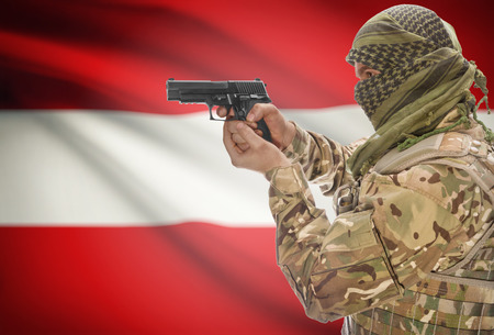 extremist: Male in muslim keffiyeh with gun in hand and national flag on background series - Austria