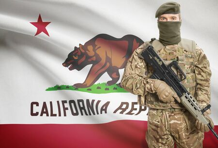 peacemaker: Soldier holding machine gun with USA state flag on background - California
