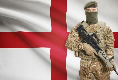 peacemaker: Soldier holding machine gun with national flag on background - England