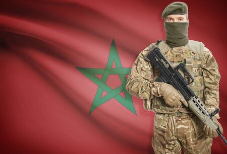peacemaker: Soldier holding machine gun with national flag on background - Morocco Stock Photo