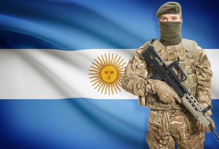 peacemaker: Soldier holding machine gun with national flag on background - Argentina