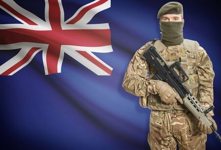 peacemaker: Soldier holding machine gun with national flag on background - New Zealand