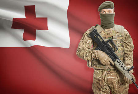 peacemaker: Soldier holding machine gun with national flag on background - Tonga
