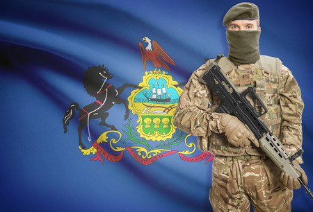 peacemaker: Soldier holding machine gun with USA state flag on background - Pennsylvania