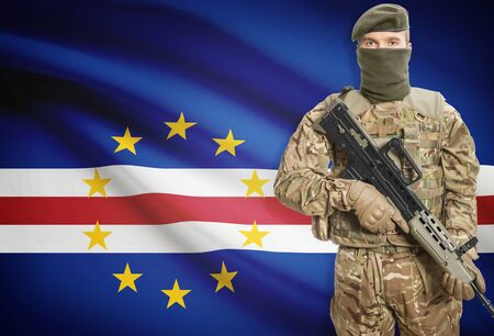 peacemaker: Soldier holding machine gun with national flag on background - Cape Verde Stock Photo