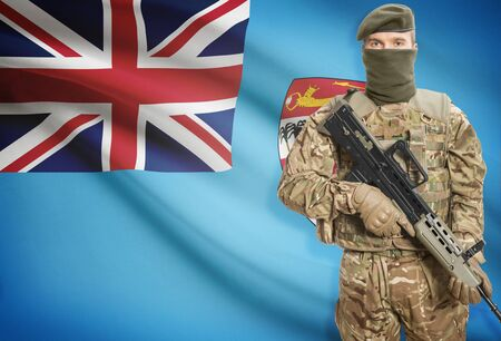 fijian: Soldier holding machine gun with national flag on background - Fiji