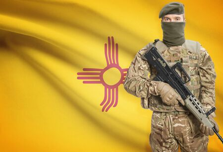 peacemaker: Soldier holding machine gun with USA state flag on background - New Mexico