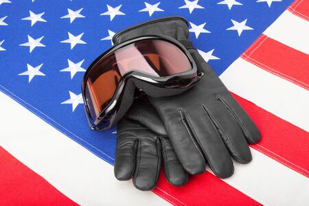 visions of america: Winter sport goggles and gloves over USA flag
