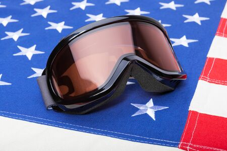 see the usa: Winter sports implements over US flag - snowboard or ski goggles