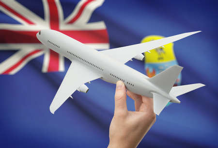 helena: Airplane in hand with national flag on background - Saint Helena