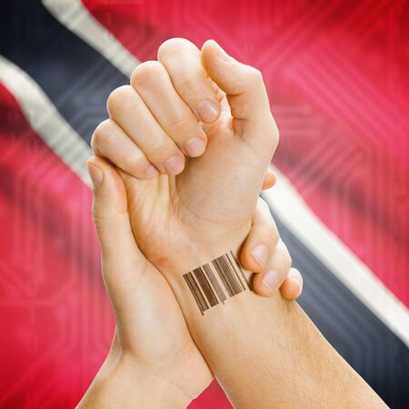 national flag trinidad and tobago: Barcode ID number on wrist of a human and national flag on background series - Trinidad and Tobago