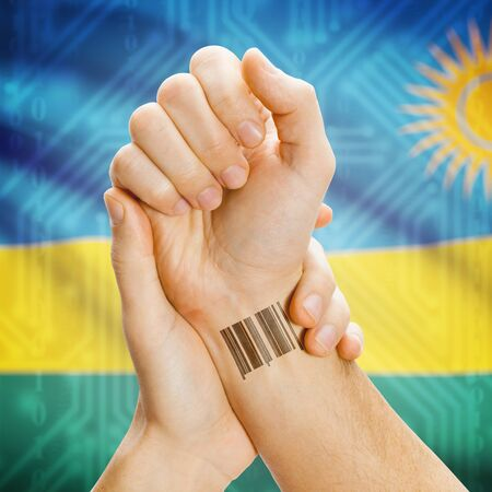 protection concept: Barcode ID number on wrist of a human and national flag on background series - Rwanda