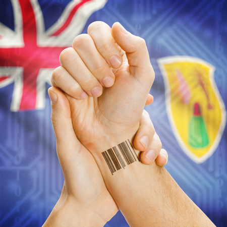 the turks: Barcode ID number on wrist of a human and national flag on background series - Turks and Caicos Islands