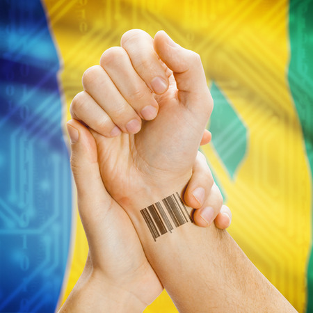 saint mark's: Barcode ID number on wrist of a human and national flag on background series - Saint Vincent and the Grenadines